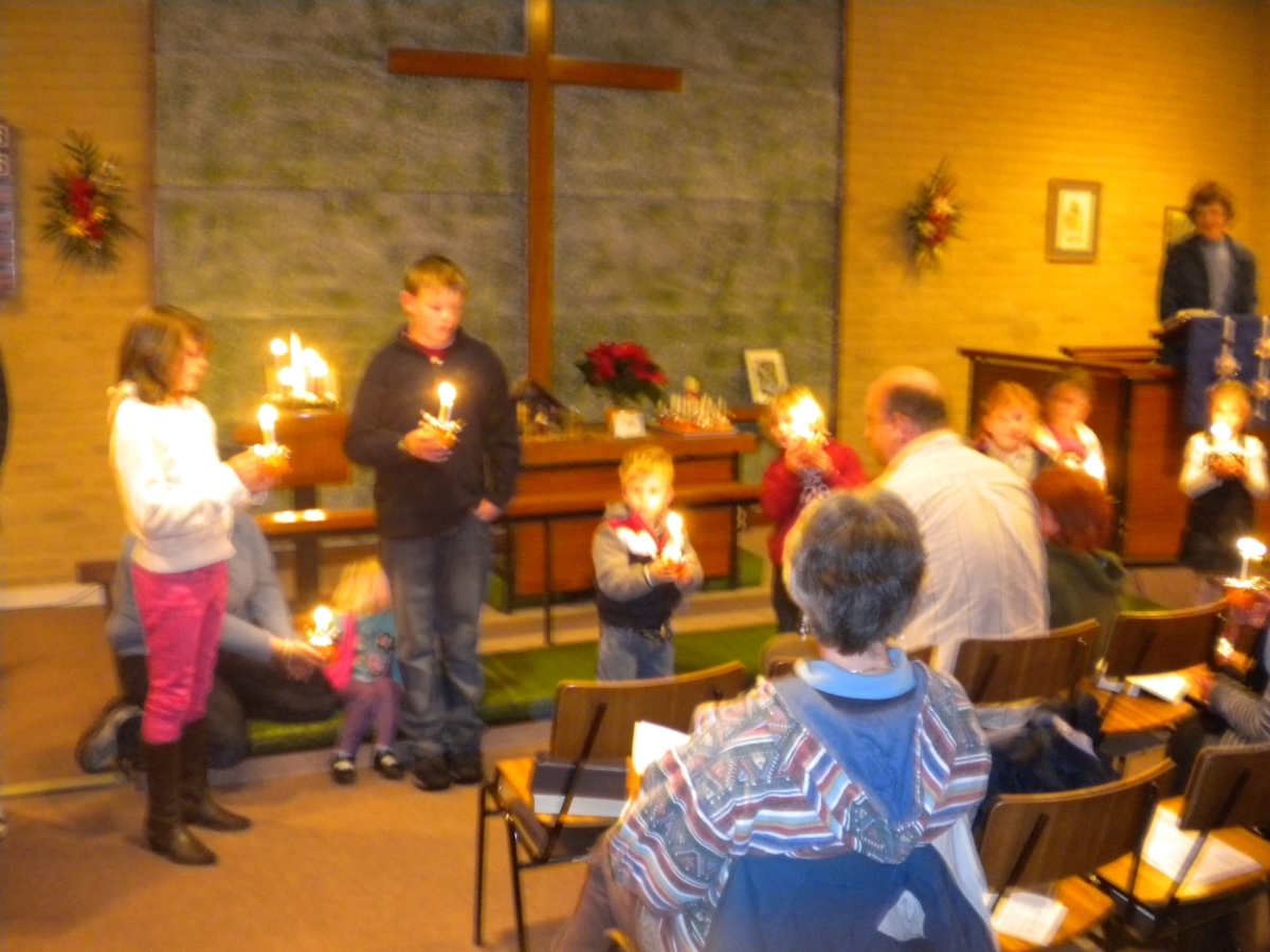 "<strong><span style=""font-size: 12pt; color: #ff0000;\"">Lighting the Candles during Christmas Carols</span></strong>"